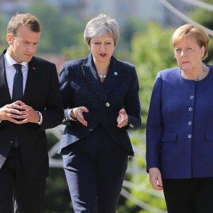 French President Emmanuel Macron (L), British Prime Minister Theresa May (C) and German Chancellor Angela Merkel walk during the EU-Western Balkans Summit in Sofia, Bulgaria on Thursday.