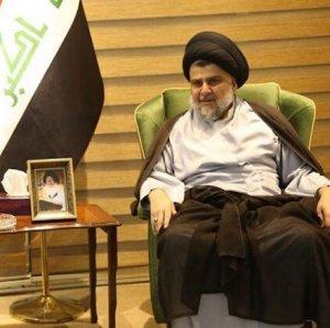 Moqtada al-Sadr (R) meets with Hadi al-Amiri, leader of  the Al-Fatih bloc, on May 20.