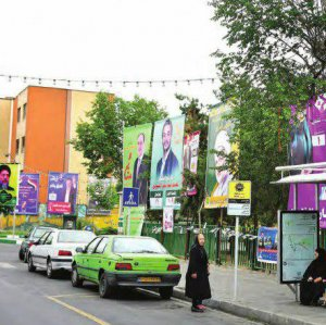 Campaign posters in a street in the predominantly Iraqi district of Dolatabad in downtown Tehran show candidates running in the May 12 parliamentary elections.