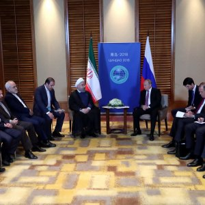 President Hassan Rouhani meets with Russian President Vladimir Putin on the sidelines of the Shanghai Cooperation Organisation (SCO) Summit in Qingdao on June 9.