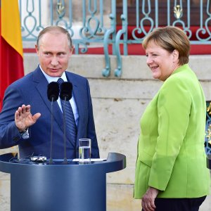 """The Kremlin said Merkel and Putin held a """"""""very serious and detailed"""" three-hour discussion during their meeting outside of Berlin, including an exchange of views on Ukraine, Syria, Iran, and a crucial pipeline project."""