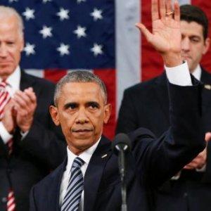 Upbeat Obama Defies Critics