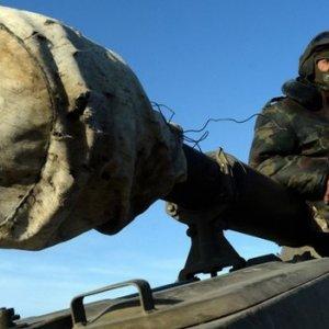 Kiev, Rebels Continue Weapons Withdrawal