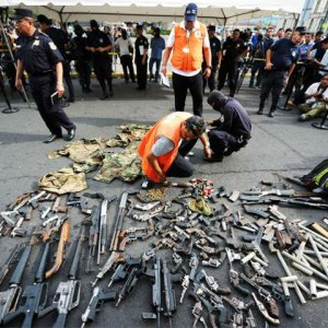 Philippine Rebels Give Up Arms