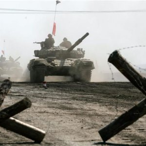 Ukraine's Warring Sides Begin  Pullback of Weapons