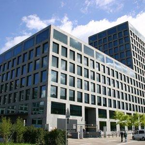 Bern Fine Tunes Plan to Retain Multinationals