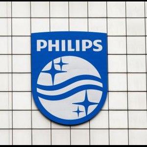 Philips Slashes Profit
