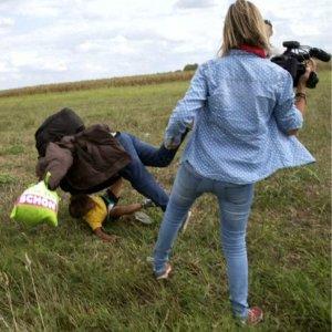 Hungarian TV Journalist Filmed  Kicking Refugee Kids