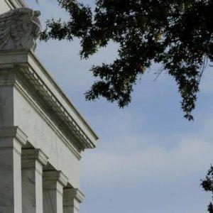 Fed Says Economy Improving