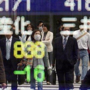 BOJ Trims Growth Prediction