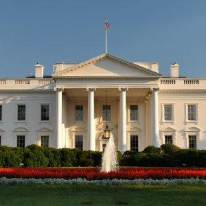 White House Slashes Deficit Forecast