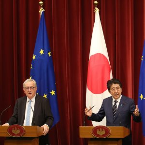 Japanese Prime Minister Shinzo Abe (C) speaks as European Commission President Jean-Claude Juncker (L) and European Council President Donald Tusk listen during  a joint press conference at Abe's official residence in Tokyo on July 17.