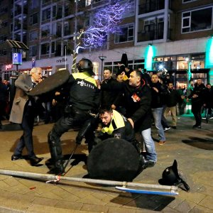 Dutch riot police clash with protesters near the Turkish consulate in Rotterdam on March 11, after a Turkish minister was barred by police from entering the consulate.