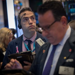 A trader works on the floor at the closing bell of the Dow Jones at the New York Stock Exchange.