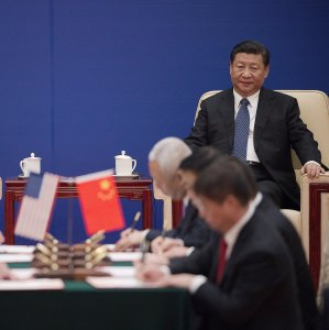 US President Donald Trump (L) and China's President Xi Jinping attend a business leaders event inside the Great Hall of the People in Beijing on Nov. 9.
