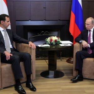 Russia's President Vladimir Putin (R) meets with his Syrian counterpart Bashar al-Assad in Sochi on November 20.