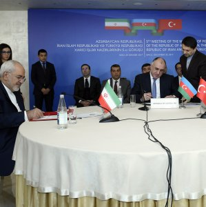 Azerbaijan's Foreign Minister Elmar Mammadyarov is flanked by his Iranian and Turkish counterparts Mohammad Javad Zarif (L) and Mevlut Cavusoglu during a meeting in Baku on Dec. 20.