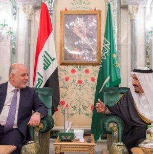 Saudi Arabia's King Salman (R) talks with Iraqi Prime Minister Haider al-Abadi in Jeddah, Saudi Arabia, on June 19.