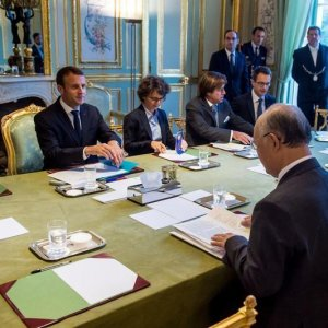 French President Emmanuel  Macron (2nd L) meets IAEA chief  Yukiya Amano (R) in Paris on Oct. 19.