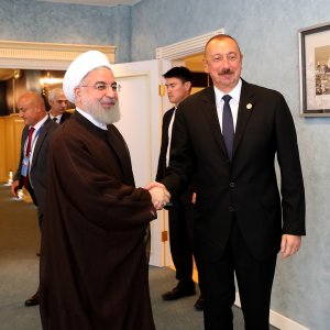 President Hassan Rouhani (L) shakes hands with Azeri President Ilham Aliyev on the sidelines of the Caspian Sea Summit in Kazakhstan on Sunday.