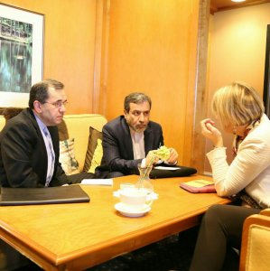 Iranian deputy foreign ministers, Majid Takht-Ravanchi (L) and Abbas Araqchi (C) meet EU political director, Helga Schmid, in Vienna on Jan. 10.