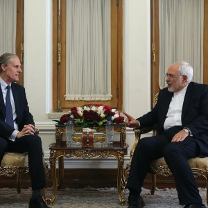 Foreign Minister Mohammad Javad Zarif (R) meets Christian Masset, a senior French Foreign Ministry official, in Tehran on June 3.