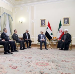 President Hassan Rouhani (R) meets Syrian Prime Minister Imad Khamis and his accompanying delegation in Tehran on Jan. 18.