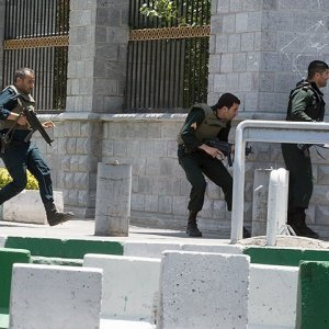 Security forces take up positions around the parliament's premises in Tehran on June 7 to fight IS terrorists holed up in one of the buildings.