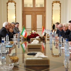 Iranian and Syrian diplomatic delegations meet in Tehran on Dec. 31.