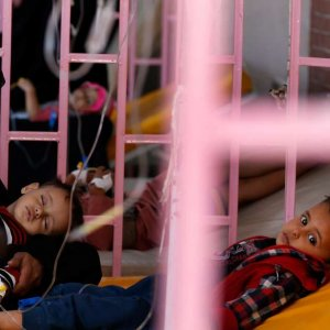 A woman sits with her sons while they are treated at a cholera treatment center in Sanaa, Yemen October 8.