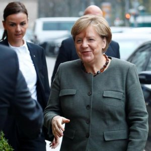 Angela Merkel arrives at the German Parliamentary Society offices for exploratory talks about forming a new coalition government in Berlin, Nov. 10.