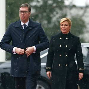 Croatia's President Kolinda Grabar Kitarovic (R) and Serbia's President Aleksandar Vucic walk in Zagreb on February 12.