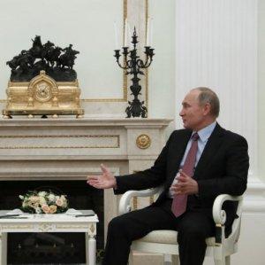 Russian President Vladimir Putin (R) meets  German President Frank Walter Steinmeier at the Kremlin in Moscow, Russia,  on October 25.