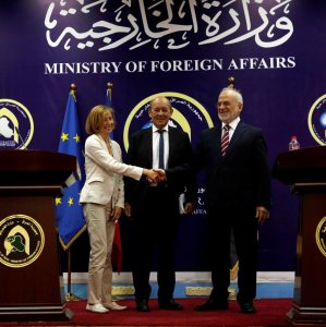 French Defense Minister Florence Parly (L) shakes hands with Iraqi Foreign Minister Ibrahim al-Jaafari with French Foreign Minister Jean-Yves Le Drian present during a joint news conference in Baghdad on August 26.