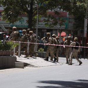 Afghan security forces arrive at the site of complex attack in Kabul, Afghanistan on July 31.