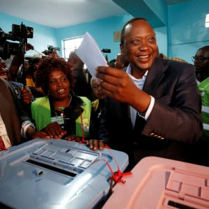 President Uhuru Kenyatta casts his ballot inside  a polling station in his hometown of Gatundu  in Kiambu county, Kenya on August 8.
