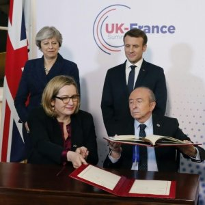May, Macron Strike Border Security Deal at UK Summit