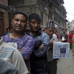 Nepalese stand in a queue to cast their votes at a polling station during the local election in Bhaktapur, Nepal, on May 14.
