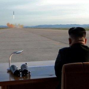 North Korean leader Kim Jong Un watches the launch of a Hwasong-12 missile in this undated photo released  by North Korea's Korean Central News Agency (KCNA) on Sept. 16.