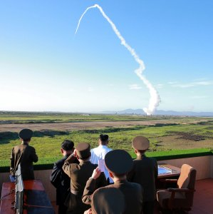 North Korean leader Kim Jong-Un (C-in white shirt) watches the test of a new anti-aircraft guided weapon system organized by the Academy of National Defense Science in Pyongyang, North Korea.