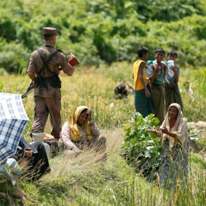 A Rohingya woman urges a member of Border Guard Bangladesh not to turn them back to Myanmar, in Cox's Bazar, Bangladesh on August 27.