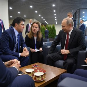 Iraqi Kurdish Prime Minister Nechirvan Barzani (L) in a meeting with Russian President Vladimir Putin in Saint Petersburg in June.