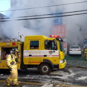 Firefighters work as smoke billows from a hospital in Miryang, South Korea on Jan. 26.