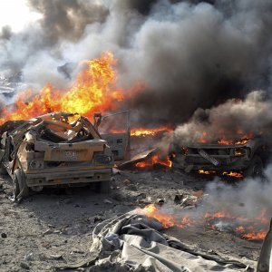 Cars burn at the scene of the bomb attack in Rukban Refugee Camp, Syria, May 15.