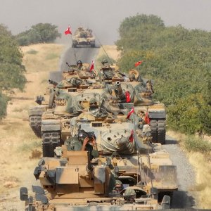 Turkish army tanks make their way towards the Syrian border town of Jarablus, Syria August 24, 2016.