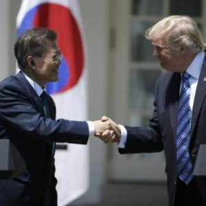President Donald Trump (R) greets South Korean President Moon Jae-in prior to delivering a joint statement from the Rose Garden of the White House, June 30.
