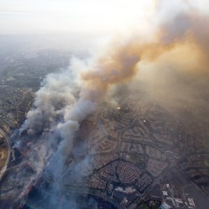 A wildfire moves closer to North Tustin homes along the 261 freeway in Tustin, Calif. on Oct. 9.