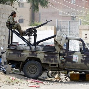 A Houthi fighter sits behind a machine gun at a checkpoint in Sanaa, Yemen on August 27.