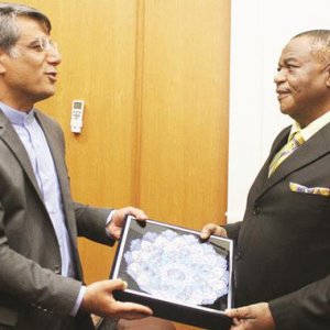 Acting President of Zimbabwe Constantino Chiwenga (R) receives a gift from Iranian Ambassador to Zimbabwe Ahmad Erfanian during a courtesy call in Harare on April 5.