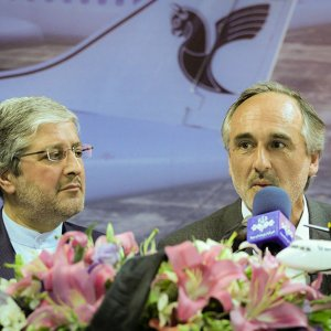 Giovanni Tramparulo (R) and Iran Air CEO Farhad Parvaresh